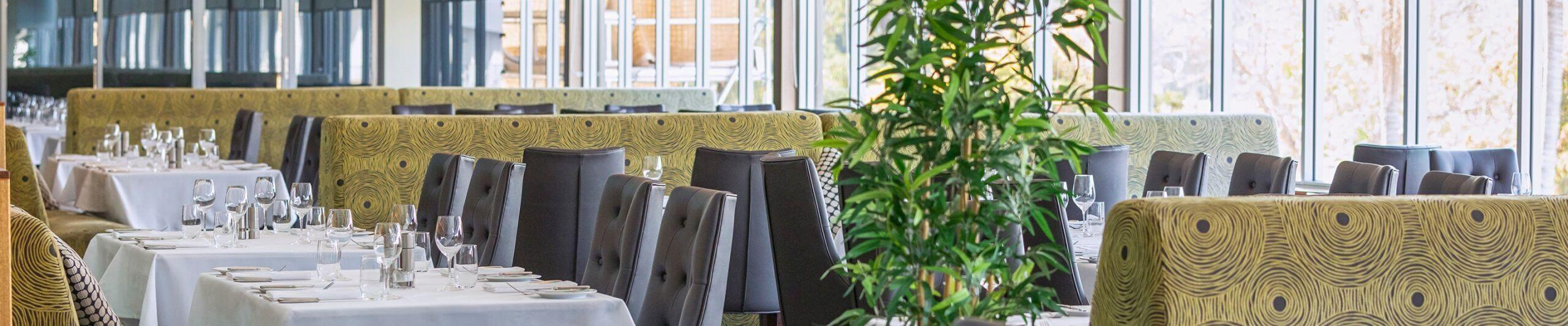 Dining tables and decorative chairs in restaurant
