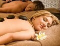 Couple enjoying hot stones spa treatment